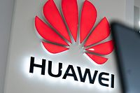 (FILES) This file picture taken on May 20, 2019 shows a Huawei logo displayed at a retail store in Beijing. - Huawei founder Ren Zhengfei on May 21, 2019 shrugged off US attempts to block his company's global ambitions, saying the United States underestimates the telecom giant as it is ready to withstand the impact. (Photo by FRED DUFOUR / AFP)