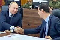 "A handout picture released by the official Syrian presidency Telegram page on January 7, 2020 shows President Bashar al-Assad (C-R) shaking the hand of his Russian counterpart Vladimir Putin (C-L) at the headquarters of the Russian forces in the Syrian capital Damascus. (Photo by - / various sources / AFP) / == RESTRICTED TO EDITORIAL USE - MANDATORY CREDIT ""AFP PHOTO / HO / SYRIAN PRESIDENCY TELEGRAM PAGE"" - NO MARKETING NO ADVERTISING CAMPAIGNS - DISTRIBUTED AS A SERVICE TO CLIENTS =="