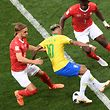 Brazil's forward Neymar (C) fights for the ball with Switzerland's defender Michael Lang (L) and Switzerland's forward Breel Embolo  during the Russia 2018 World Cup Group E football match between Brazil and Switzerland at the Rostov Arena in Rostov-On-Don on June 17, 2018. / AFP PHOTO / KHALED DESOUKI / RESTRICTED TO EDITORIAL USE - NO MOBILE PUSH ALERTS/DOWNLOADS