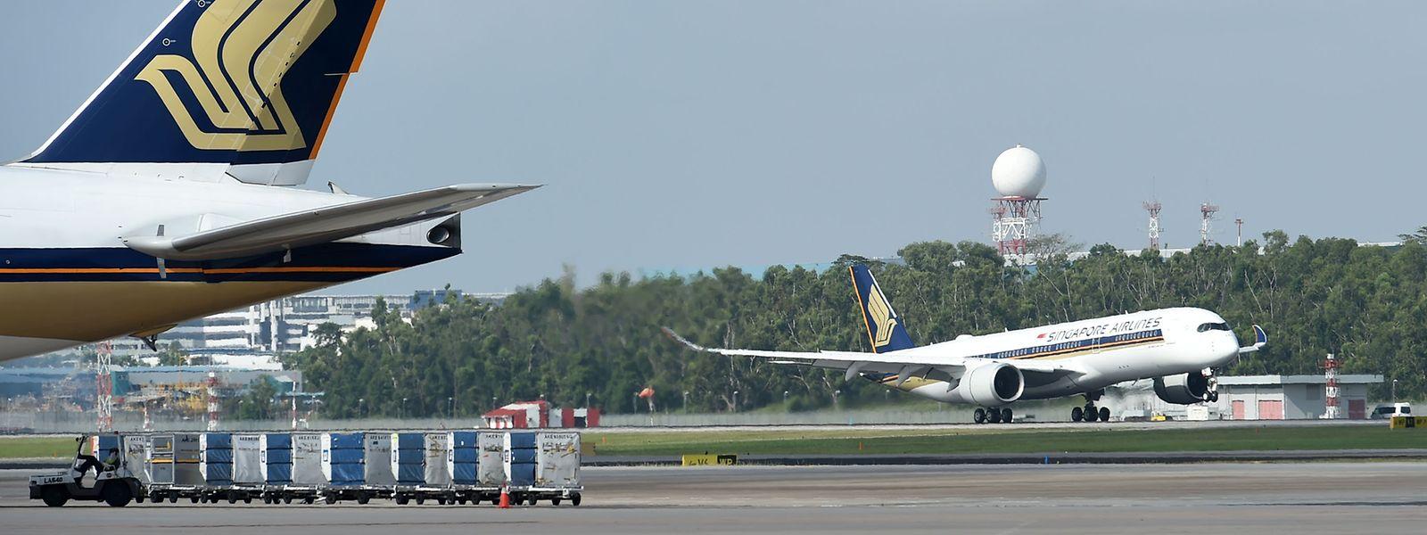Des passagers se préparaient jeudi à embarquer sur le plus long vol au monde: un marathon de près de 19 heures entre Singapour et New York.