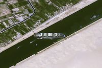 """This handout satellite images courtesy of Cnes 2020 released on March 25, 2021 by Airbus DS shows the Taiwan-owned MV 'Ever Given' (Evergreen) container ship, a 400-metre- (1,300-foot-)long and 59-metre wide vessel, lodged sideways and impeding all traffic across the waterway of Egypt's Suez Canal. - The owners of a giant container vessel blocking the Suez Canal said they faced """"extreme difficulty"""" refloating it as Egypt temporarily closed one of the world's busiest shipping lanes. (Photo by - / CNES / AFP) / RESTRICTED TO EDITORIAL USE - MANDATORY CREDIT """"AFP PHOTO / CNES 2020"""" - NO MARKETING NO ADVERTISING CAMPAIGNS - DISTRIBUTED AS A SERVICE TO CLIENTS ---"""
