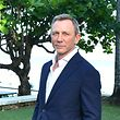 "(FILES) In this file photo taken on April 24, 2019 actor Daniel Craig attends the ""Bond 25"" film launch at Ian Fleming's Home ""GoldenEye"" on April 25, 2019 in Montego Bay, Jamaica. - British actor Daniel Craig will undergo ""minor ankle surgery"" after an injury on the set of the latest James Bond film, but his operation and recovery will not affect the film's expected release next year, producers said May 22, 2019. Craig -- who will play the legendary British super spy for the fifth time in the as-yet untitled film -- sustained the injury ""during filming in Jamaica,"" a statement on the official James Bond Twitter account said. (Photo by Slaven Vlasic / GETTY IMAGES NORTH AMERICA / AFP)"