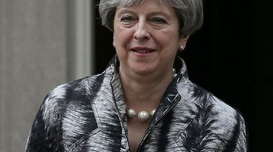 Britain's Prime Minister Theresa May leaves after a cabinet meeting at 10 Downing Street.