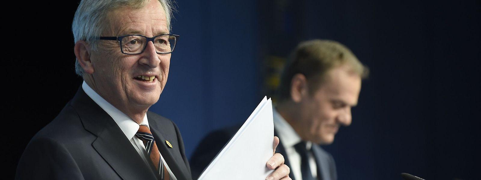 Jean-Claude Juncker e Donald Tusk durante a conferência de imprensa conjunta