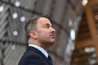 Luxembourg's Prime Minister Xavier Bettel addresses media representatives as he arrives on the first day of a European Union (EU) summit at The European Council Building in Brussels on June 24, 2021. - . (Photo by JOHN THYS / POOL / AFP)