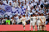 Real Madrid's players celebrate after scoring a goal during the Spanish League football match between Real Madrid and Girona at the Santiago Bernabeu stadium in Madrid on February 17, 2019. (Photo by GABRIEL BOUYS / AFP)