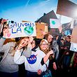 "Students hold signs reading ""save the planet"" as they take part in a 'Youth For Climate' march on February 14, 2019 in Jodoigne. - This marks the sixth consecutive week youths take the streets on Thursday, the action spread from Brussels through the rest of the country. (Photo by JASPER JACOBS / BELGA / AFP) / Belgium OUT"