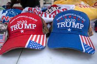 Merchandise featuring US Donald Trump is displayed at a booth in Tulsa, Oklahoma, June 19, 2020. - US President Donald Trump will hold his first rally since the outbreak of the coronavirus pandemic on June 20 in Tulsa. (Photo by SETH HERALD / AFP)