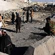 Afghan security personnel gather at the site of a suicide attack at a police compound in Maiwand district of Kandahar province on December 22, 2017. A suicide bomber drove an explosives-packed Humvee into a police compound in Afghanistan on December 22, killing at least six officers and destroying a building, officials said.�The Taliban claimed responsibility for the pre-dawn attack on the Maiwand district police headquarters in the southern province of Kandahar. It was the latest deadly assault by the insurgents, who have been increasingly targeting security installations. / AFP PHOTO / JAVED TANVEER
