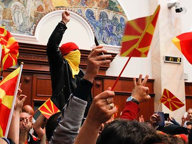 Protesters entered Macedonia's parliament after the governing Social Democrats and ethnic Albanian parties voted to elect an Albanian as parliament speaker in Skopje. Macedonia April 27, 2017. REUTERS/Ognen Teofilovski