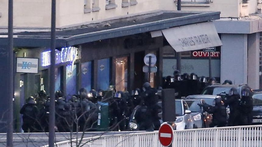 Members of the French police special forces launch the assault at a kosher grocery store in Porte de Vincennes, eastern Paris, on January 9, 2015 where at least two people were shot dead on January 9 during a hostage-taking drama at a Jewish supermarket in eastern Paris