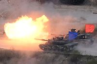 (FILES) In this file photo taken on April 26, 2017 A South Korean K1A2 tank (blue) and a US M1A2 tank (red) fire live rounds during a joint live firing drill between South Korea and the US at the Seungjin Fire Training Field in Pocheon, 65 kms northeast of Seoul. - The US and South Korea said on March 3, 2019 they will end their annual large-scale joint military exercises as Washington pursues efforts to improve ties with North Korea. (Photo by JUNG Yeon-Je / AFP)