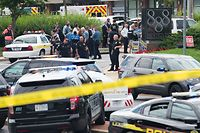 "Police respond to a shooting at the offices of the Capital Gazette, a daily newspaper, in Annapolis, Maryland, June 28, 2018.  The local ABC7 news reported ""multiple fatalities"" quoting police in the historic city located an hour east of Washington. ""ATF Baltimore is responding to a shooting incident at the Capital Gazette in Annapolis,"" the Bureau of Alcohol, Firearms, and Tobacco said on Twitter. County Sheriff Ron Bateman told Fox News a suspect had been taken into custody.  / AFP PHOTO / SAUL LOEB"