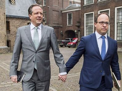 Politicians from Democrats 66 party, Alexander Pechtold (L) and Wouter Koolmees (R), arrived a meeting in Le Hague holding hands to show support for the movement