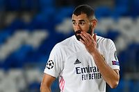 Real Madrid's French forward Karim Benzema reacts at the end of the UEFA Champions League group B football match between Real Madrid and Shakhtar Donetsk at the Alfredo di Stefano stadium in Valdebebas on the outskirts of Madrid on October 21, 2020. (Photo by GABRIEL BOUYS / AFP)
