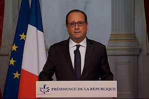 In this TV grab image taken on November 13, 2015 French president Francois Hollande adresses the nation from Paris after a series of gun attacks occurred across Paris as well as explosions outside the national stadium where France was hosting Germany. Francois Hollande declared a state of emergency and closed borders.   AFP PHOTO /