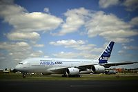 (FILES) This file photo taken on July 14, 2014 shows an Airbus A380-800 taxiing for take off at the Farnborough air show in Hampshire. - European aerospace giant Airbus said on February 14, 2019 it would end production of the A380 superjumbo, the double-decker jet which earned plaudits from passengers but failed to win over enough airlines to justify its massive costs. (Photo by CARL COURT / AFP)