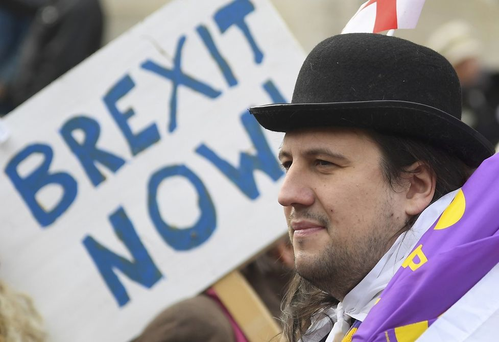 Demonstrators supporting Brexit outside of the Houses of Parliament in London