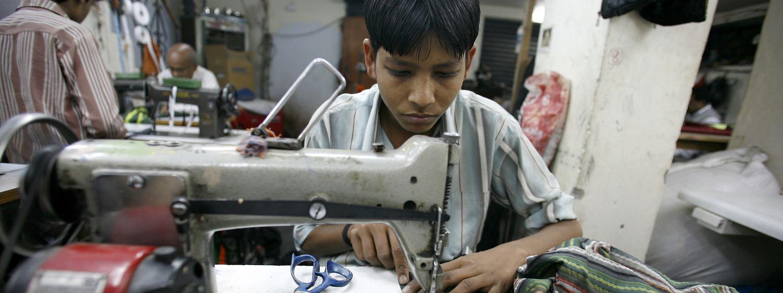 In Neu-Delhi, der Hauptstadt Indiens, werden Kinder in Textilfabriken beschäftigt.