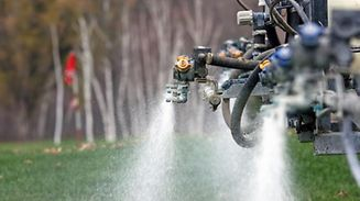Liquid pesticides spraying out of golf course sprayer   Glyphosat