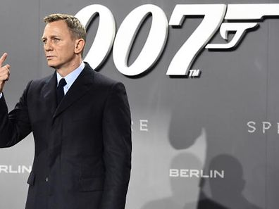 British actor Daniel Craig poses for photographers at a photocall for the new James Bond film 'Spectre' on October 28, 2015 in Berlin.   AFP PHOTO / TOBIAS SCHWARZ