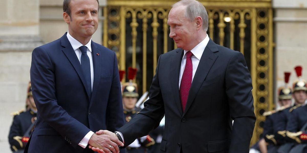 French President Emmanuel Macron shakes hands with Russian President Vladimir Putin during a meeting at the Chateau de Versailles near Paris, May 29, 2017.