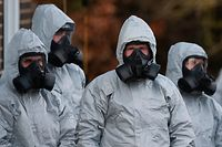 (FILES) In this file photo taken on March 10, 2018 Personnel in protective coveralls and breathing equiptment work at the Salisbury District Hospital in Salisbury, southern England, on March 10, 2018, in connection with the major incident sparked after a man and a woman were apparently poisoned in a nerve agent attack. A British couple left critically ill in an English town were exposed to Novichok -- the same nerve agent used in the poisoning of a former Russian spy Sergei Skripal and his daughter Yulia Skripal in the nearby city of Salisbury this year, police said on July 5, 2018. / AFP PHOTO / Daniel LEAL-OLIVAS