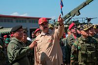 "Handout picture released by the Venezuelan presidency showing Venezuela's President Nicolas Maduro (C) speaking to a commander during military exercises at the Naval Base Agustin Armario in Puerto Cabello, Carabobo State, Venezuela, on January 27, 2019. - Maduro on Sunday rejected a European ultimatum that he call elections as opposition rival Juan Guaido stepped up appeals to the military to turn against the leftist government. (Photo by HO / Venezuelan Presidency / AFP) / RESTRICTED TO EDITORIAL USE - MANDATORY CREDIT ""AFP PHOTO / VENEZUELAN PRESIDENCY"" - NO MARKETING NO ADVERTISING CAMPAIGNS - DISTRIBUTED AS A SERVICE TO CLIENTS"