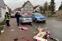 A broken handcart is seen in front of cars of the police, the fire brigades and an ambulance on Rose Monday, February 24, 2020 in Volkmarsen near Kassel, central Germany. - Several people were injured when a car drove into a carnival procession in Volksmarsen, police said, adding that the driver had been arrested. (Photo by Elmar SCHULTEN / AFP)