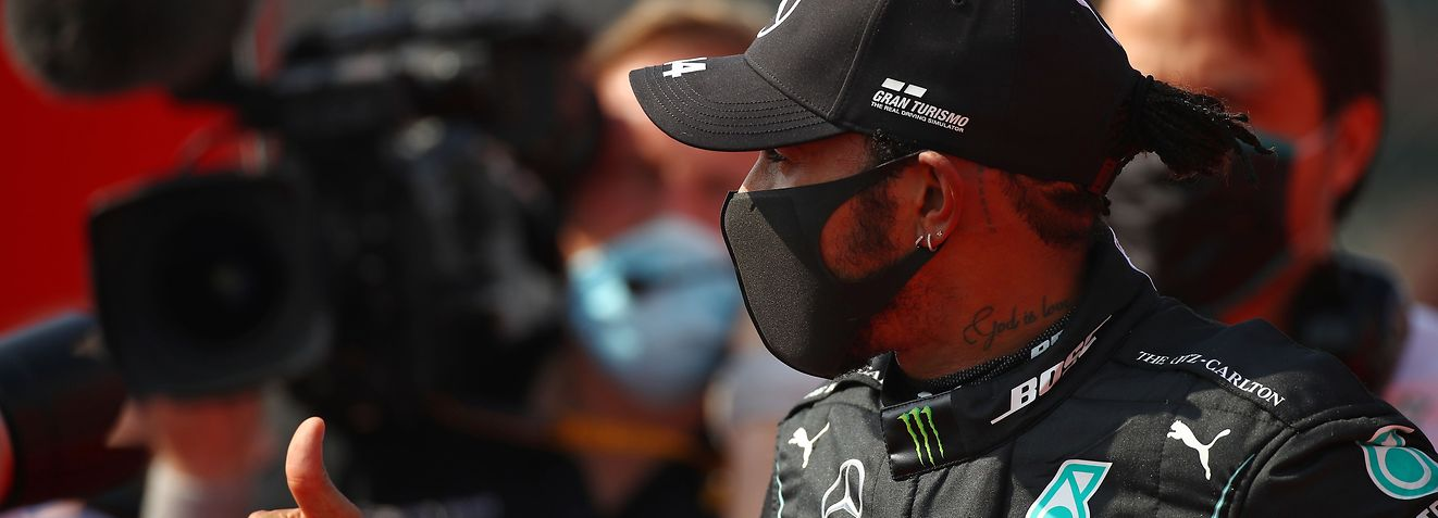Mercedes' British driver Lewis Hamilton gestures at the end of the race during the F1 70th Anniversary Grand Prix at Silverstone on August 9, 2020 in Northampton. - The race commemorates the 70th anniversary of the inaugural world championship race, held at Silverstone in 1950. (Photo by Bryn Lennon / POOL / AFP)