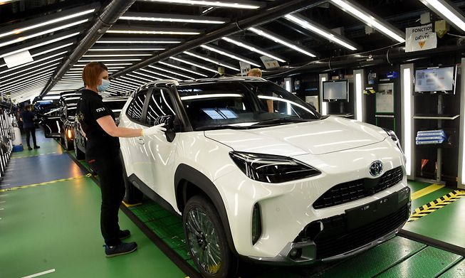 An employee checks a newly completed Toyota Yaris Cross at the Toyota manufacturing plant in northern France.