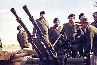 (FILES)--In this photograph made available by the official Iraqi presidential photographer 26 April 2002, Iraqi President Saddam Hussein is seen at the Iraq-Iran border during Iraq-Iran war 1980-1988. Saddam will celebrate his 65th birthday on 28 April. He was born in 1937 in Takrit, in the province of Salahedin, 170 kms north of Baghdad. AFP PHOTO/HO (Photo by PRESIDENTIAL PALACE / AFP)