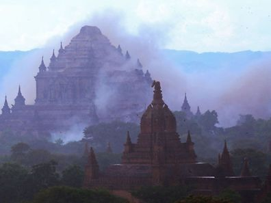 The ancient Dhammayangyi temple is seen shrouded in dust as a 6.8 magnitude earthquake hit Bagan on August 24, 2016. A powerful 6.8 magnitude earthquake struck central Myanmar on August 24, killing at least one person and damaging pagodas in the ancient city of Bagan, officials said. The quake, which the US Geological Survey said hit at a depth of 84 kilometres (52 miles), was also felt across neighbouring Thailand, India and Bangladesh, sending panicked residents rushing onto the streets.   / AFP PHOTO / SOE MOE AUNG