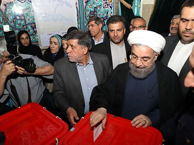 Iran's President Hassan Rouhani casts his ballot during the presidential election