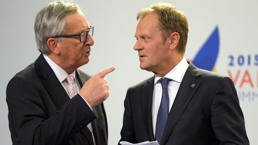 European Commission President Jean-Claude Juncker (L) speaks with European Council President Donald Tusk after a press conference following an Informal EC meeting and an EU-Africa Summit on Migration on Thursday in La Valletta.