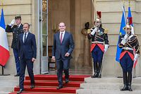 Former French Prime Minister Edouard Philippe (L) and newly-appointed Prime Minister Jean Castex (C) arrive to give a speech during the handover ceremony in the courtyard of the Matignon Hotel in Paris on July 3, 2020. (Photo by Ludovic Marin / AFP)