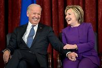 """(FILES) In this file photo former US Vice President Joe R. Biden (L) and former Secretary of State Hillary Clinton laugh during a portrait unveiling for outgoing Senate Minority Leader Senator Harry Reid (D-NV) on Capitol Hill December 8, 2016 in Washington, DC. - Former Democratic presidential candidate Hillary Clinton is to hold a video conference with Joe Biden on April 28, 2020 during which she is expected to endorse his White House bid. Clinton, who headed the Democratic ticket against Republican Donald Trump in 2016, announced on Twitter that she would be the """"surprise guest"""" at a virtual town hall with Biden at 3:00 pm (1900 GMT) to discuss the impact of the coronavirus pandemic on women. (Photo by Brendan Smialowski / AFP)"""