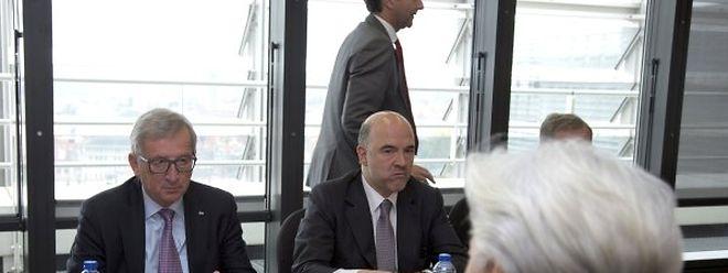 Juncker e Moscovici durante uma reunião com a directora do FMI, Christine Lagarde, a 24 de Junho