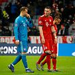 Bayern Munich's German goalkeeper Manuel Neuer (L) and Bayern Munich's German defender Niklas Suele react after the UEFA Champions League, last 16, second leg football match Bayern Munich v Liverpool in Munich, southern Germany, on March 13, 2019. (Photo by Odd ANDERSEN / AFP)