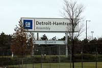 "A sign is viewed at the General Motors Detroit-Hamtramck Assembly as they announced the closing of multiple facilities including this one on November 26, 2018 in Detroit, Michigan. - In a massive restructuring, US auto giant General Motors announced Monday it would cut 15 percent of its workforce to save $6 billion and adapt to ""changing market conditions."" The moves include shuttering seven plants worldwide as the company responds to changing customer preferences and focuses on popular trucks and SUVs and increasingly on electric models.GM will shutter three North American auto assembly plants next year: the Oshawa plan in Ontario, Canada; Hamtramck in Detroit, Michigan and Lordstown in Warren, Ohio.In addition, it will close propulsion plants -- which produce batteries and transmissions -- in Baltimore, Maryland and Warren, Michigan, as well two more unidentified plants outside of North America. (Photo by JEFF KOWALSKY / AFP)"