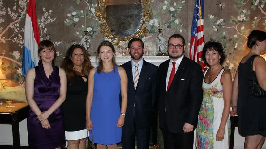 Prince Guillaume and Princess Stéphanie with General Consul Jean-Claude Knebeler and members of the Luxembourg House team