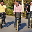 (FILES) In this file photo taken on June 17, 2017 French President Emmanuel Macron (C) rides a bicycle in the streets of Le Touquet, northern France, accompanied by Elysee senior security officer Alexandre Benalla (L).  One of President Emmanuel Macron's top security officers was at the centre of a potentially damaging scandal for the French leader on July 19, 2018 after being filmed hitting a protester. Le Monde newspaper published a video showing Alexandre Benalla striking and then stamping on a young man while wearing a police visor during a demonstration in central Paris on May 1.  / AFP PHOTO / CHRISTOPHE ARCHAMBAULT