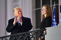 US President Donald Trump applauds Judge Amy Coney Barrett after she was sworn in as a US Supreme Court Associate Justice during a ceremony on the South Lawn of the White House October 26, 2020, in Washington, DC. (Photo by Nicholas Kamm / AFP)