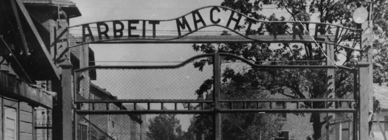 """FILE - An undated image shows the main gate of the Nazi concentration camp Auschwitz in Poland.  Writing over the gate reads: """"Arbeit macht frei"""" (Work Sets You Free). A 94-year-old man who was deported from the U.S. for lying about his Nazi past was ordered released from custody Friday Dec. 6, 2013 after a German court said it has """"serious doubts"""" that he is fit to stand trial on charges he served as an Auschwitz death camp guard. The state court in Ellwangen,  said in a statement it had concluded that Hans Lipschis was suffering from the onset of dementia, based on two meetings with the suspect and a psychiatric assessment, and that he was easily disoriented.  (AP Photo/File)"""