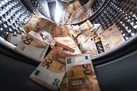 money laundering concept - euro banknotes in washing machine