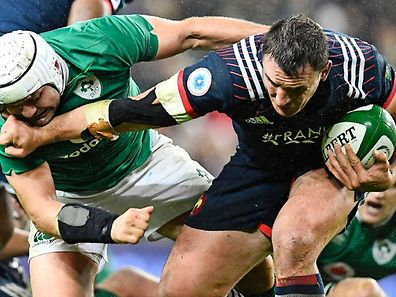 Ireland's hooker Rory Best (L) vies with France's number 8 Louis Picamoles during the Six Nations international rugby union match between Ireland and France at the Aviva Stadium in Dublin on February 25, 2017.   / AFP PHOTO / FRANCK FIFE