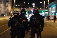 French police officers block the road near the site where Cherif Chekatt, the alleged gunman who had been on the run since allegedly killing three people at Strasbourg's popular Christmas market, has been shot dead by police on December 13, 2018 in the Neudorf neighbourhood of Strasbourg. - More than 700 French security forces had been hunting for 29-year-old Chekatt since the bloodshed on December 11. (Photo by Alain JOCARD / AFP)