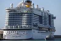 A Guardia di Finanza boat patrol around the Costa Smeralda cruise ship docked in the Civitavecchia port 70km north of Rome on January 30, 2020. More than 6,000 tourists were under lockdown aboard the cruise ship after two Chinese passengers were isolated over fears they could be carrying the coronavirus. - Samples from the two passengers were sent for testing after three doctors and a nurse boarded the Costa Crociere ship in the port of Civitavecchia to tend to a woman running a fever, the local health authorities said. (Photo by Filippo MONTEFORTE / AFP)