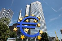 The EURO logo is pictured at the European Central Bank, ECB in Frankfurt/Main, central Germany, on July 3, 2014.  The bank is to move into the new building end of 2014. AFP PHOTO / DANIEL ROLAND