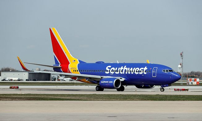 A Southwest Airlines Boeing 737-7H4 jet taxis to the gate after landing at Midway International Airport in Chicago, Illinois